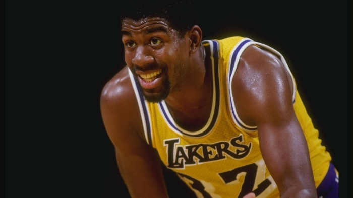Guard Magic Johnson of the Los Angeles Lakers stands on the court during a game at the Great Western Forum in Inglewood, California - Photo Courtesy of The Sports Post