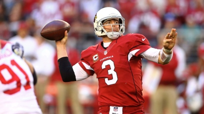 Carson Palmer, quarterback for the Arizona Cardinals, looks downfield for an open receiver - Photo Courtesy of Fantasy Guru Bros
